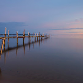 Traverse City Sunrise by Greg Weseman - Landscapes Waterscapes ( clouds, water, waterscape, pier, sunrise )