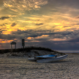 A New Day by Madeline McDonald - Landscapes Beaches ( water, clouds, sand, sky, pier, sunrise, beach, boat, sun )