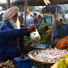 grocery vendor by Samir Ray - People Street & Candids ( colour, market, groceries, vendor, light )