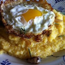 Grits with Old Bay and Rosemary Frizzled Shallots and an Olive Oil Fried Egg