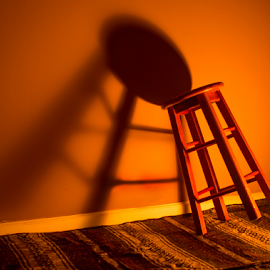 All That's Left by Kyle Volz - Artistic Objects Furniture ( orange, chair, shadow, empty, wall, room, Chair, Chairs, Sitting, Lighting, moods, mood lighting )