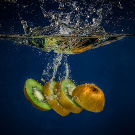 Sliced and Splashed by Troy Wheatley - Food & Drink Fruits & Vegetables ( water, dunk, fruit, splash, drop, kiwi, sliced, wet )