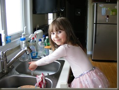 Ella washing her hands