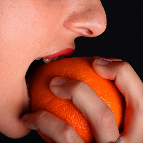 Hunger by Adrian Chinery - Food & Drink Eating ( orange, fruit, bite, woman, bitter, lady, hungry, teeth, nose, peel,  )