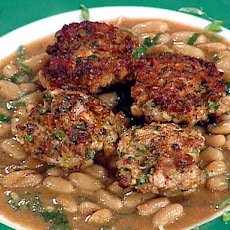Grilled Rabbit Sausage over Stewed White Beans