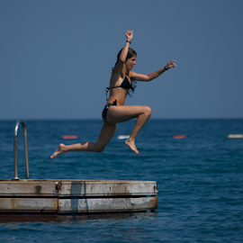 Girl in black bikini jumping into water by Nick Dale - People Street & Candids ( water, platform, girl, sea, turkey, bikini, bodrum, diving, black, jump )