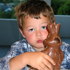 Do I have to finish it? by Vibeke Friis - Food & Drink Eating ( rabbit, chocolate, tired, boy,  )