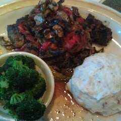 Smothered Sirloin Tips, Red Skinned Mashed Potatoes & Steamed Broccoli.   Wonderful!