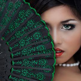 Hiding by Theo Widharto - People Portraits of Women ( girl, green, green eyes, hiding girl, fan, portrait,  )