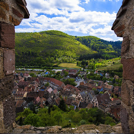 The View From A Tower  by Lillian Molstad Andresen - Buildings & Architecture Homes ( clouds, hills, houses, april, 2014, château de kaysersberg, architecture, alcase province, landscape, tower, sky, frame, window, nature, vineyards, roofs, trees, france, view, homes, kaysersberg city,  )