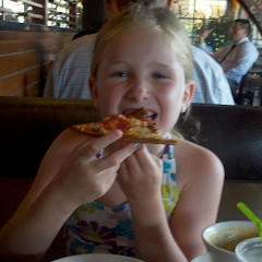 My daughter eating the delicious gluten free pizza at BJs restaurant.