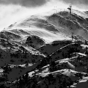wind and snow by Gregor Znidarsic - Landscapes Mountains & Hills ( clouds, wind, hills, mountains, b&w, snow, sun )