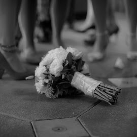 girl down. by Luis Rivera - Wedding Reception ( bouquet, black and white, wedding, bouquet toss, flowers, Emotion, portrait, human, people )
