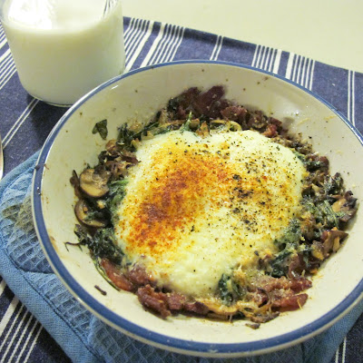 Parmesan Baked Eggs Over Bacon, Mushroom, Leek, And Arugula Hash
