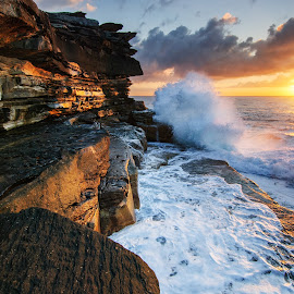 Dragon Island by Anton Gorlin - Landscapes Waterscapes ( orange, splash, cliff, rock, ocean, seascape, morning, island, dawn, australia, wave, cloud, power, sunrise, light, foam, clovelly, sydney, energy )