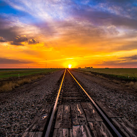 Sunset on Tracks by Brandon Green - Landscapes Sunsets & Sunrises ( clouds, train tracks, sunset, railroad, texas, weather, sun )