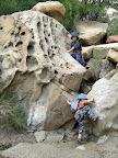 Michael and Bradley climbing boulders
