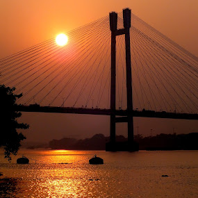 Sunset on Ganges by Mainak Adak - Landscapes Sunsets & Sunrises ( water, reflection, nature, sunset, cityscape, landscape )