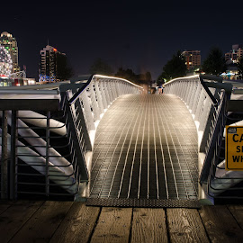 Foot Bridge at Night by Cory Bohnenkamp - Buildings & Architecture Bridges & Suspended Structures ( foot bridge, olympics, false creek, vancouver, science world, athletes village )