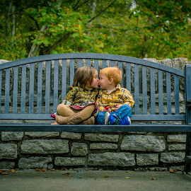 Park Bench Kisses by Brandi Davis - Babies & Children Children Candids ( sister, kiss, bench, fall, outdoors, trees, children, bridge, brother, public, furniture, object,  )