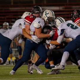 Smothering Defense by Kevin Mummau - Sports & Fitness American and Canadian football ( defense, teamwork, hugging, team, tackle, helmet )