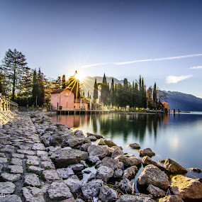 A silent morning. by Mattia Bonavida - Landscapes Waterscapes ( clouds, exposure, water, garda, reflections, lake, surise, long, mountains, d800e, sky, nature, trees, stones, nikon, italy )