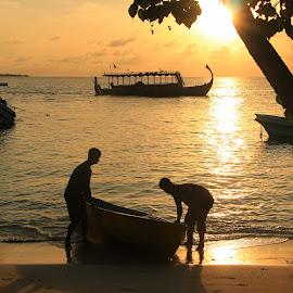 boat crew by Tony Walker - Transportation Boats ( boats, sea, silhouettes, ocean, men, sunrise )