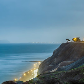 Miraflores by Denis Spray - City,  Street & Park  Night ( lighthouse, city lights, cityscape, ocean view, nightscape )