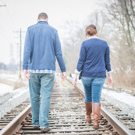 Away we go by Eric Galey - People Couples ( railroad tracks, warm, rope, bright, blue, sunny, couple, tracks, knot, golden hour )
