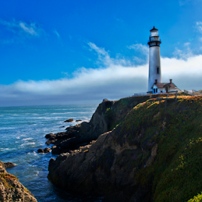 Pegion Point Lighthouse by Irma Mason - Landscapes Waterscapes ( orange, california, lighthouse, ocean, beauty, scenic, landscape, coast, pegion point, blue, sunset, sunsets, tide, pegion point lighthouse, rocks, california coast, Spring, springtime, outdoors )