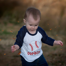 in the field by Carole Brown - Babies & Children Children Candids ( walking, little boy, butterflys, baseball shirt )