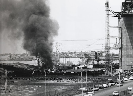 Shortly after the Westgate Bridge collapse, fire still burning. Oct 15, 1970