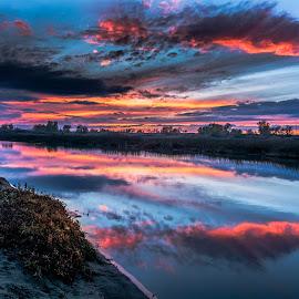 Rural West Sunset Afterglow by Bob Juarez - Landscapes Sunsets & Sunrises ( grasses, clouds, sand, sunset, marsh )
