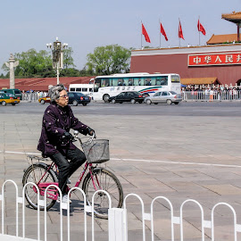 You are never too old by Vibeke Friis - Sports & Fitness Cycling ( tienenam square, bike, old lady, beijing, china, Bicycle, Sport, Transportation, Cycle, Bike, ResourceMagazine, Outdoors, Exercise, Two Wheels )