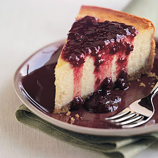 Orange Blossom Cheesecake with Raspberry and Pomegranate Sauce