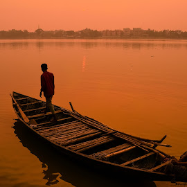 Another Voyage by Ananda Joardar - Transportation Boats ( sunset, travel, boat, people )