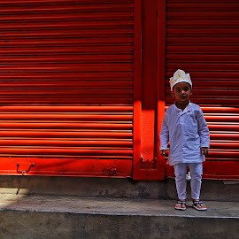 IN FRONT OF LINES by Chinmoy Biswas - Babies & Children Child Portraits ( child, colorful, street, lines )