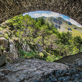 Under... by Marek Saj - Landscapes Mountains & Hills ( mountain, mountain village, wales, framed, under, stone, rock, forest, mountains, frame, trees, snodonia, bridge, stones, rocks )