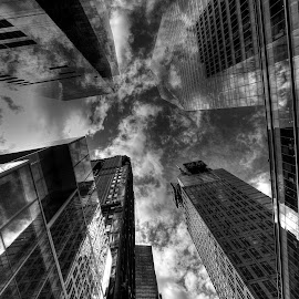 Smoke And Mirrors by Linda Edgecomb - Buildings & Architecture Office Buildings & Hotels ( skyline, america, black and white, skyscrapers, cloudscape, manhattan, architecture, storm, business, sky, traffic, skyscraper, offices, new york city, world, travel photography, travel locations )