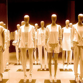 Mannequins by Ronnie Caplan - Artistic Objects Clothing & Accessories ( monochromatic, fashion, window display, mannequins, clothing, bald, storefront, figures, lineup )