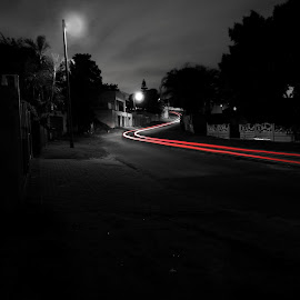Car trails by Julian Carelsen - Abstract Light Painting ( car, houses, red, light painting, path, square, road, bnw, selective color, pwc )