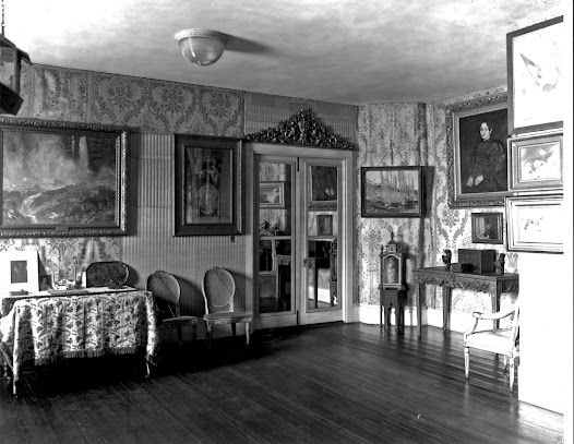 Look closely: can you spot the object missing in the previous image that does appear in this historic photo of the Blue Room from 1926?