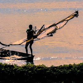 Fisherman with Boatman by Mirza N. Islam - People Street & Candids ( boatman, silhouette, fisheman, fishing, boat, river )