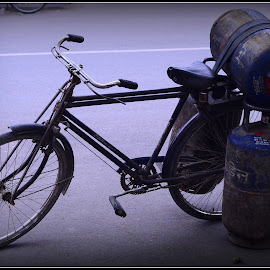 Optimal Load by Prasanta Das - Transportation Bicycles ( gas cylnders, three, bicycle )