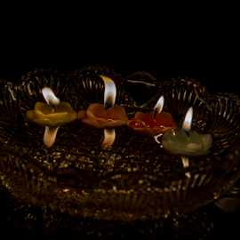 Candle on a plate by Anupam Bhoumick - Artistic Objects Cups, Plates & Utensils