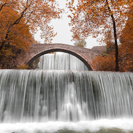 Autumn Falls by Bill Peppas - Landscapes Waterscapes ( water, stream, hellas, waterfalls, flowing, kalabaka, kalambaka, waterfall, greece, flow, leaves, autumn, kalampaka, trees, bridge, river )