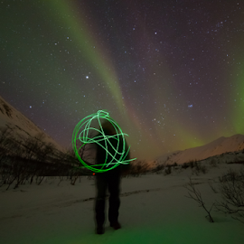 Green ball by Geir Hammer - Abstract Light Painting ( red, green, snow, aurora, northern light, winter norway, people )