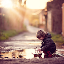 My Boat by Claire Conybeare - Chinchilla Photography - Babies & Children Toddlers ( playing, england, sweet, winter, chinchilla photography, little boy, outdoors, dunstable, puddle, cute, boat, toddler )