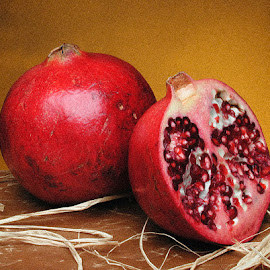 Pomegranates   by James Farnum - Food & Drink Fruits & Vegetables ( fruit still life, pomegranates   with raffia, red pomegranates, friuts, pomegranates still life, pomegranates,  )