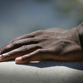 Black hand by Mike O'Connor - People Body Parts ( hand, support, nails, black, steady )